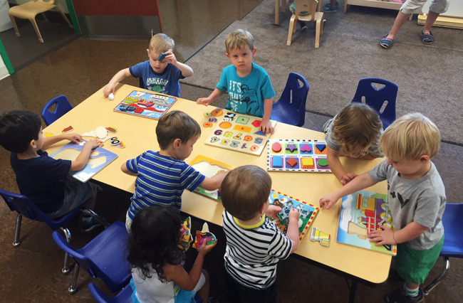 Little toddlers play with blocks in a Primrose classroom