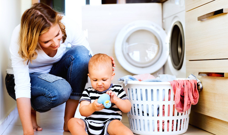 image of mom helping son while doing laundry