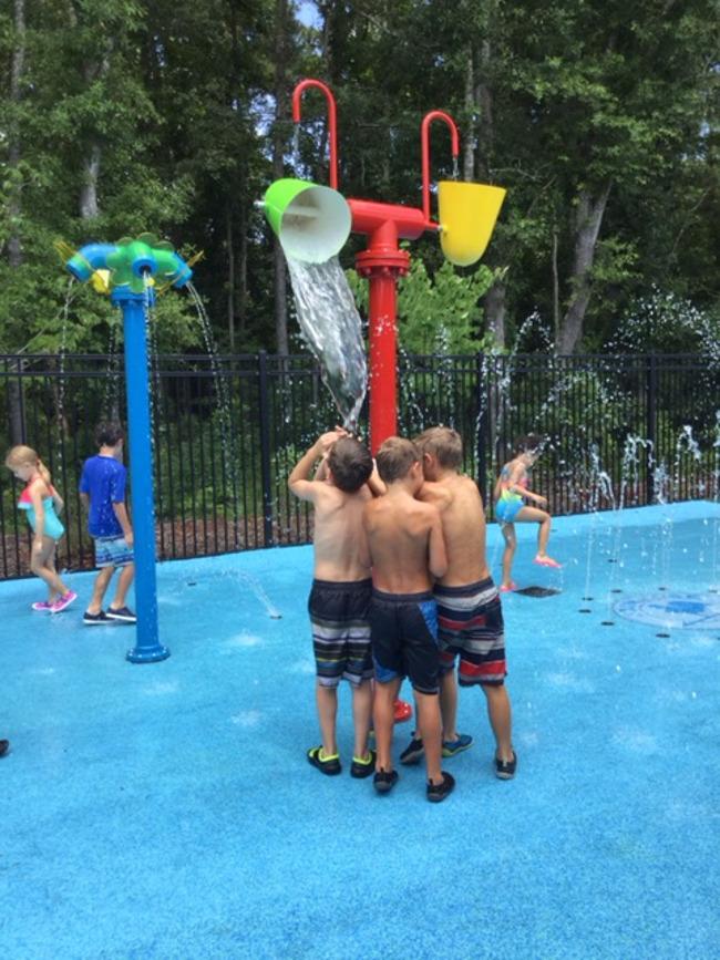 Students enjoy at the splash pad at Primrose school of Mount Pleasant