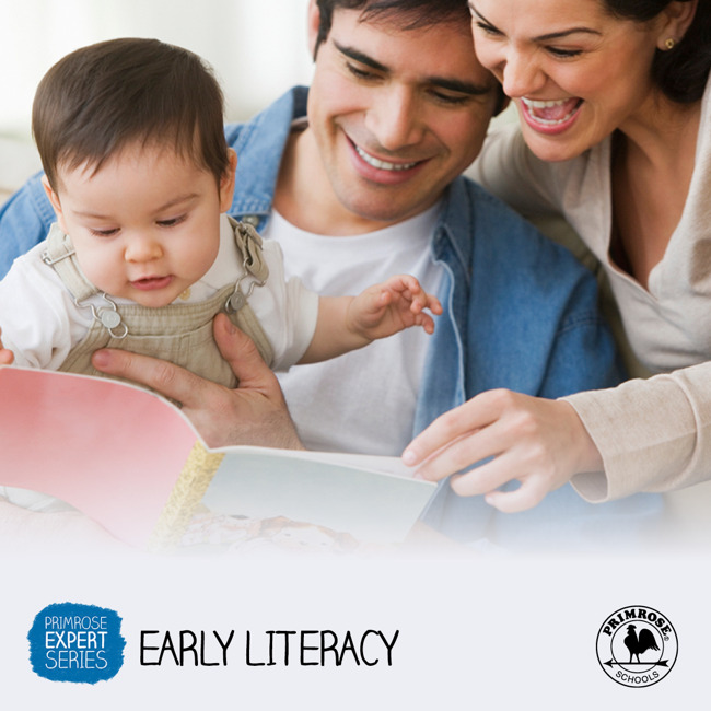 Mother and father read to their baby boy as he points excitedly at the book