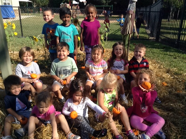 Primrose students pose with little pumpkins at the pumpkin patch