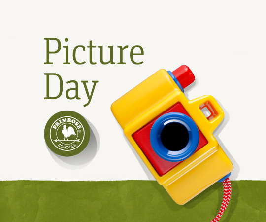"""A yellow, red, and blue toy camera is pictured underneath the caption """"Picture Day"""""""
