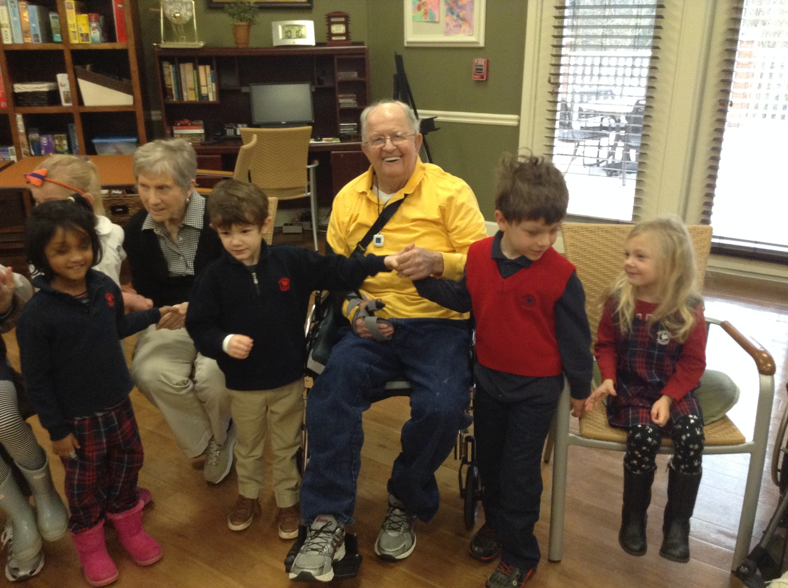 Primrose pre schoolers pose with an elderly couple for a picture