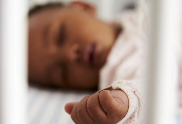 image of baby sleeping in crib