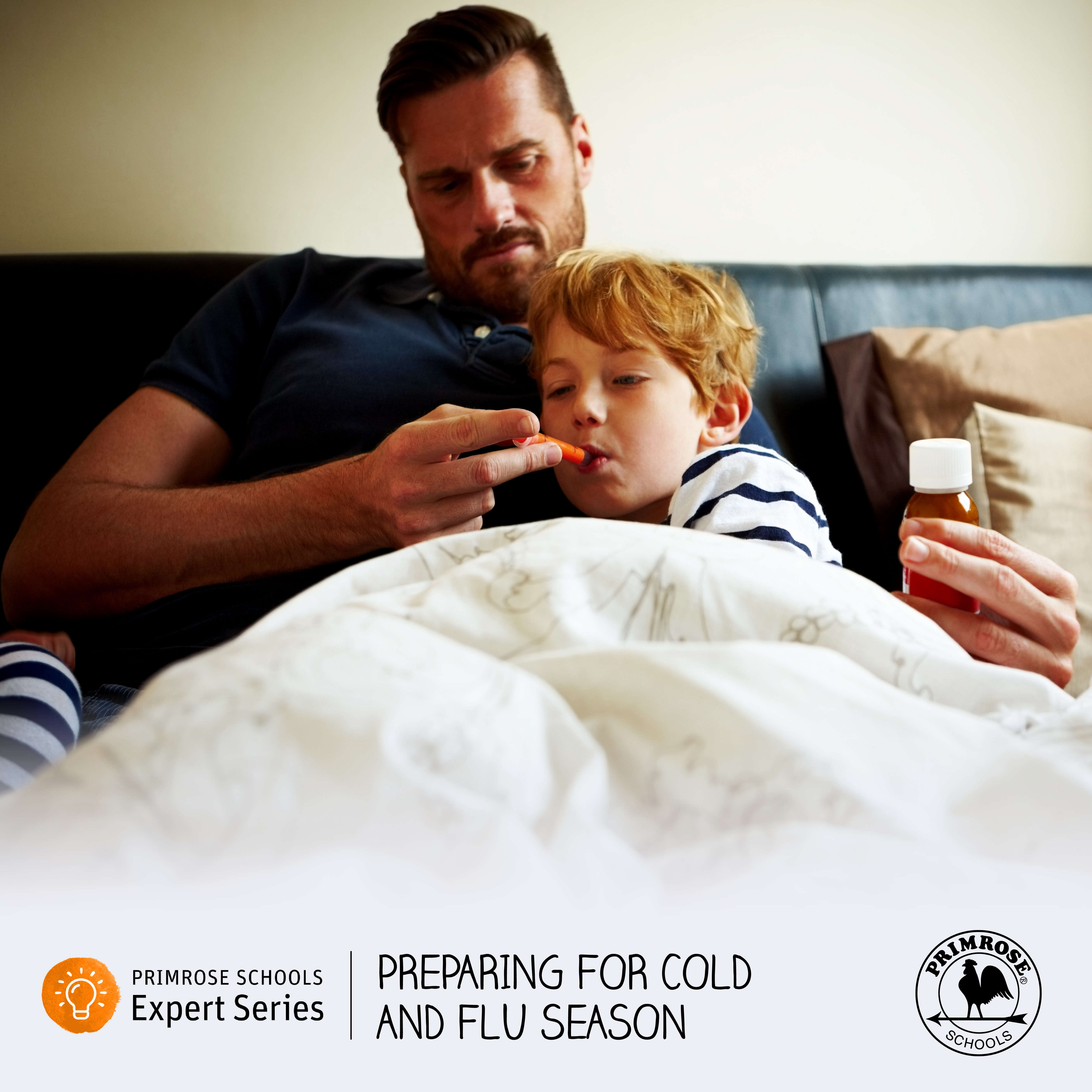 Sick boy with dad on couch