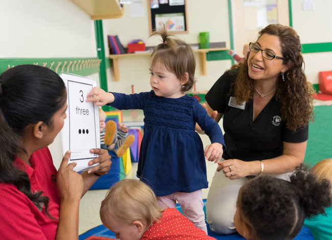 image of teachers teaching to toddlers