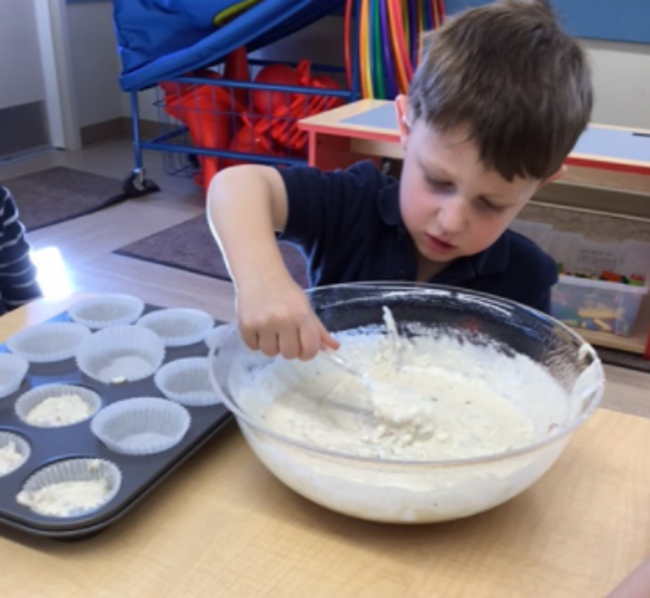 Pre-kindergarten works on their math by making muffins!
