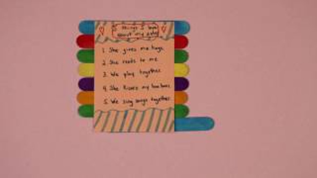 Roll up card made from colored paper and popsicle sticks