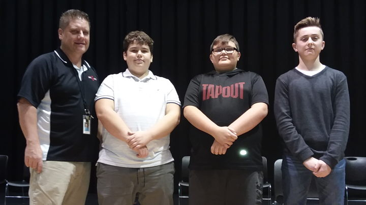Pictured is Teacher Anton Kos with Geography Bee winners, Eric Viera, Anthony Mudryk and Chaz Ekrionk