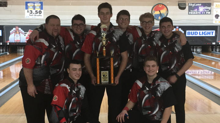 Struthers High School Boys Bowling Team with their G-Men Tournament trophy.
