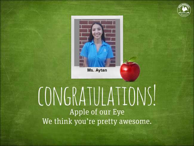 Apple of the eye with picture of Aytan in blue Primrose uniform shirt smiling