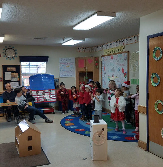 kids perform carols for their parents
