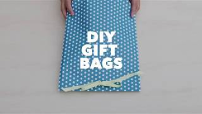blue gift bag with a white polka dots and a ribbon