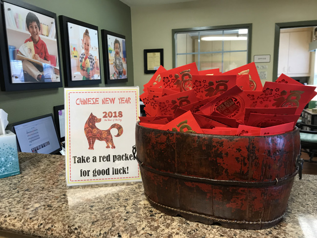 It's the Year of the Dog!  Students are encouraged to partake in the red envelope tradition at pick up this evening!