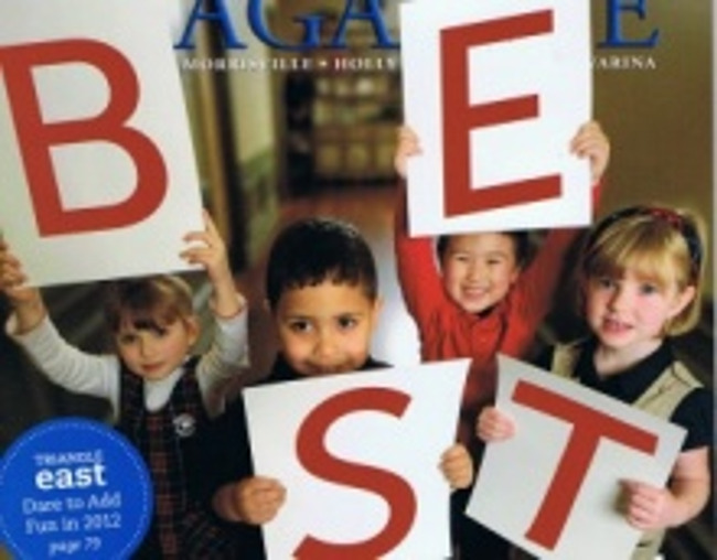 """Primrose students hold up cards that spell out the word """"BEST"""""""