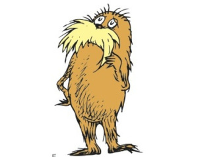 The Lorax from the Dr. Seuss book (of the same name) stands with his hand on his chin