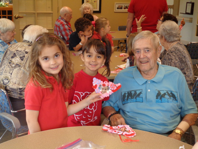 Young Primrose students pose with a senior citizen from the Windsor on Valentine's day