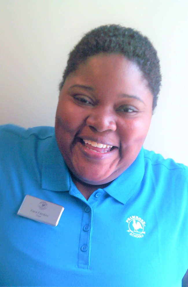 image of a woman in a blue shirt smiling