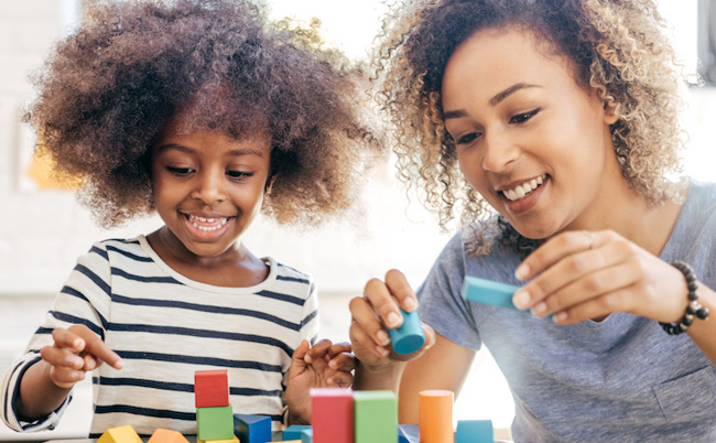 image of mother and daughter playing with blocks