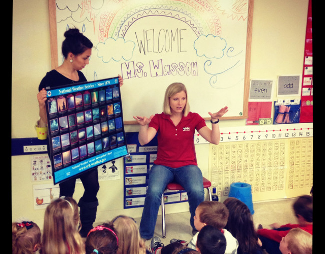 YNN Meteorologist, Mary Wasson explains weather using a chart full of images to students at Primrose school of Shady Hollow