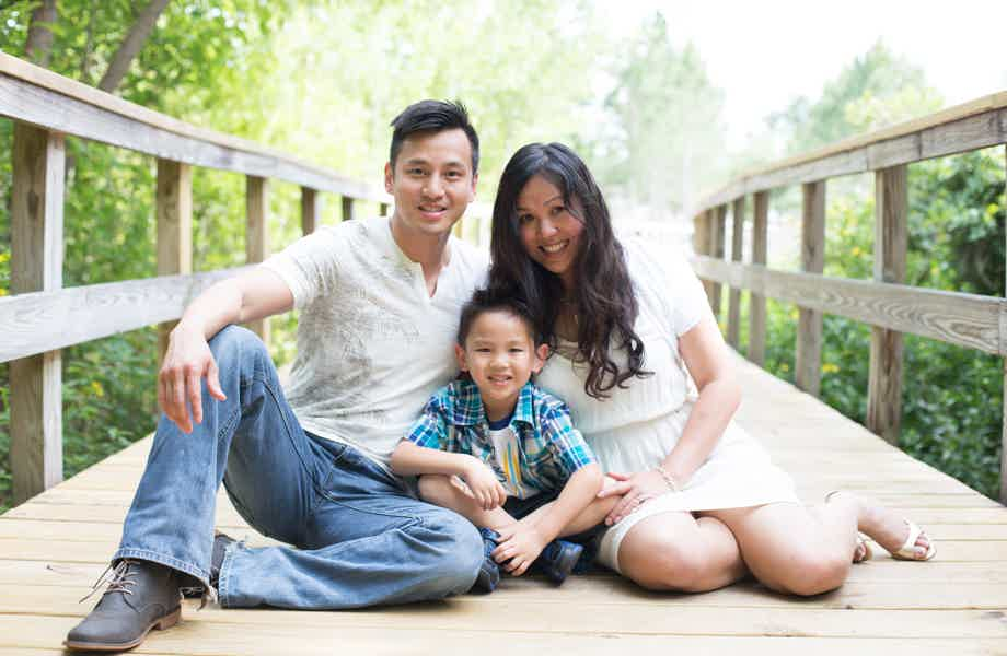 Franchise Owners of Primrose School Sandy and Shi Deng with their son