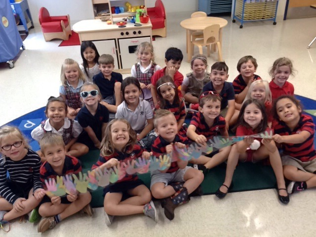 Photo of Pre-K students showing off their huge hug