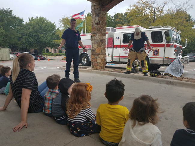 Firefighters speaking to preschoolers