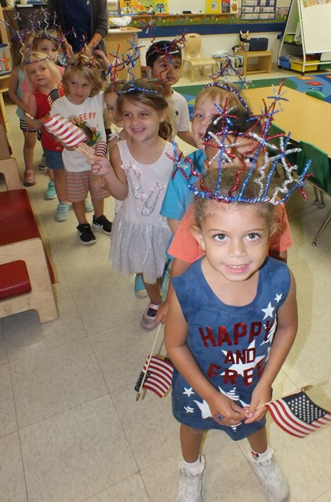 Primrose students celebrate fourth of july with flags and DIY decorative headbands