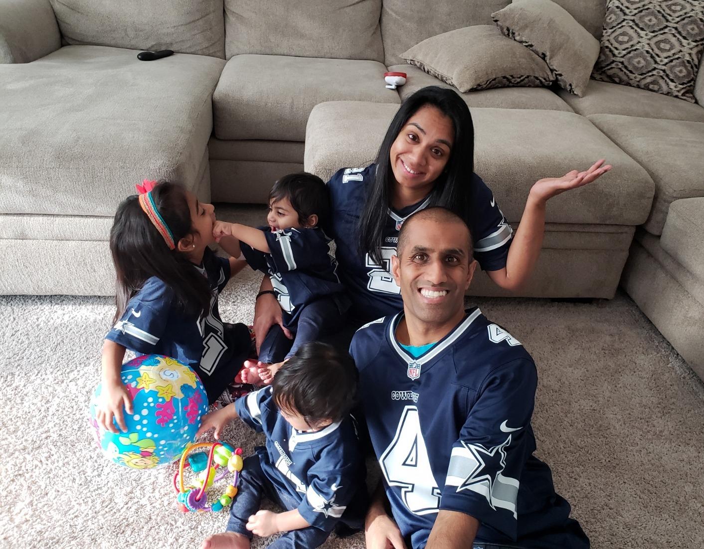 The Desai Family in Cowboys attire in the living room