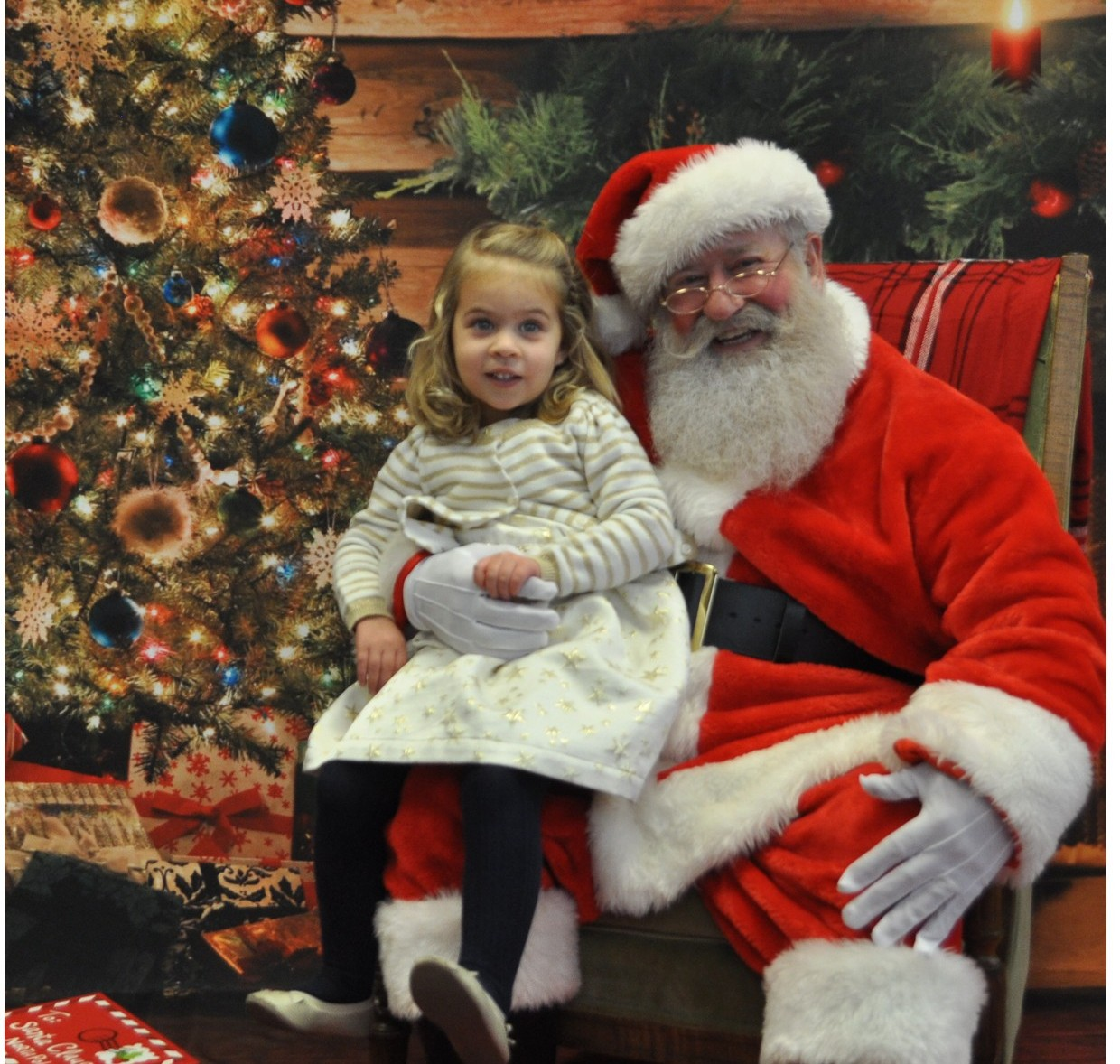 Santa and child at Breakfast with Santa event for Primrose School of St. Charles at Heritage located in St. Peters