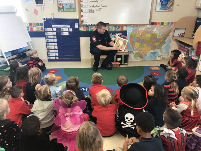 """Allen Fire Chief Williams Reading """"No Dragons for Tea"""" to Primrose East Allen students!"""