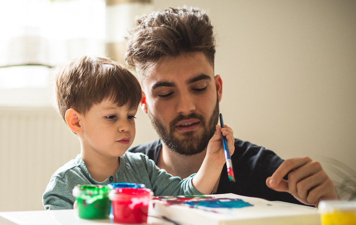 Image of son and father painting