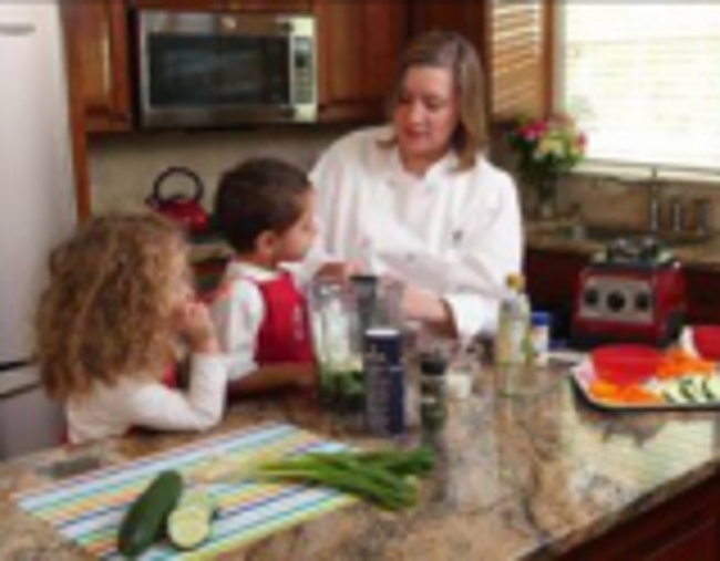 Primrose chef explains to two students how to make a snack
