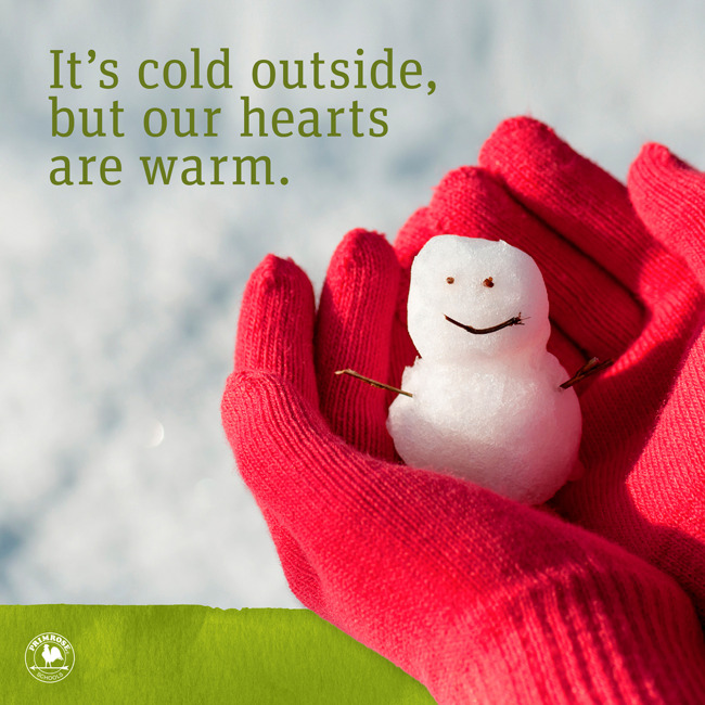Happy winter poster featuring a close up of a little snowman placed in a girls hands