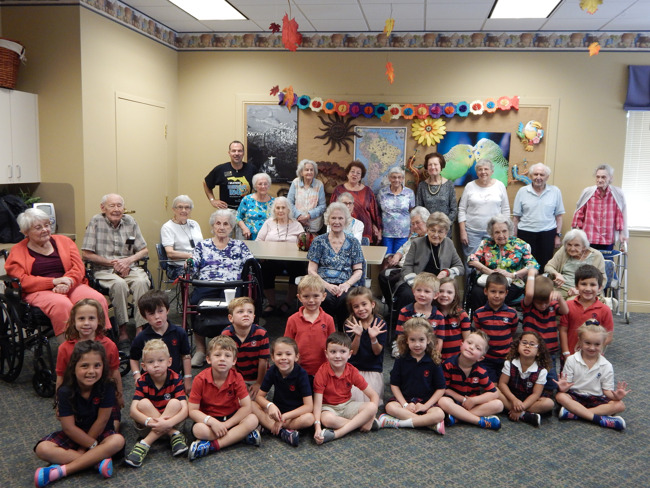 Primrose Kindergarten class poses with their special friends, the residents of The Windsor