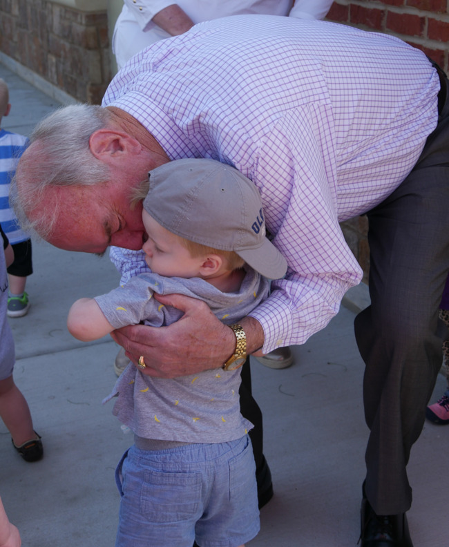Grandpa and Grandson hugs after a fun morning at our grandparent event.