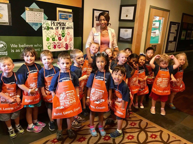 Primrose students wearing aprons at the Home Depot visit