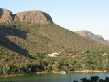 Typical view of the Dam and Magaliesberg from Kosmos Village (1).JPG