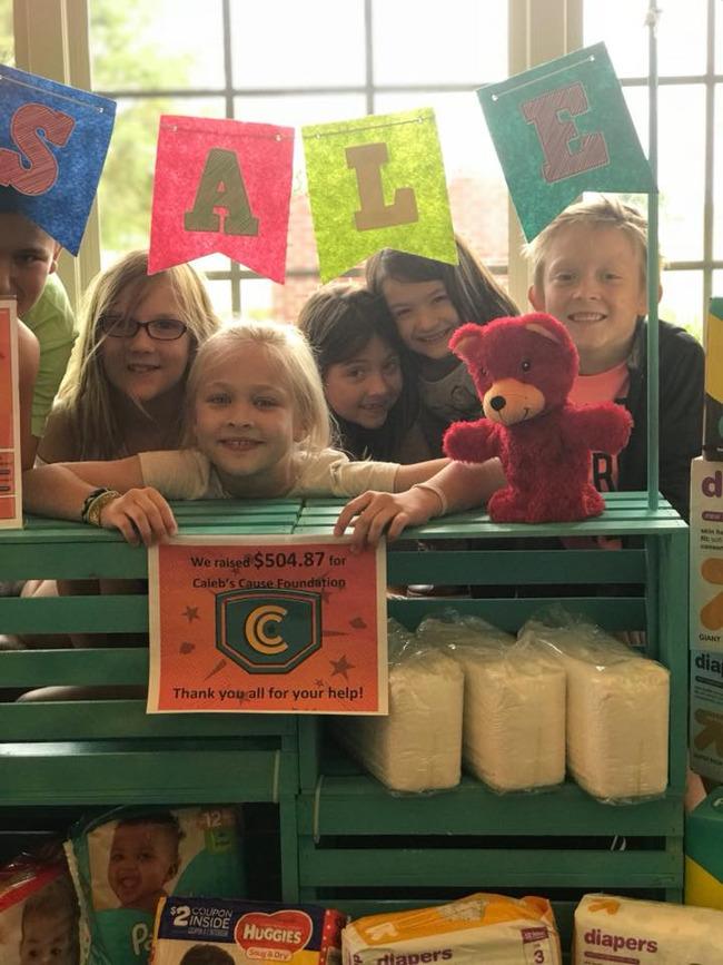 students posing in their lemonade stands