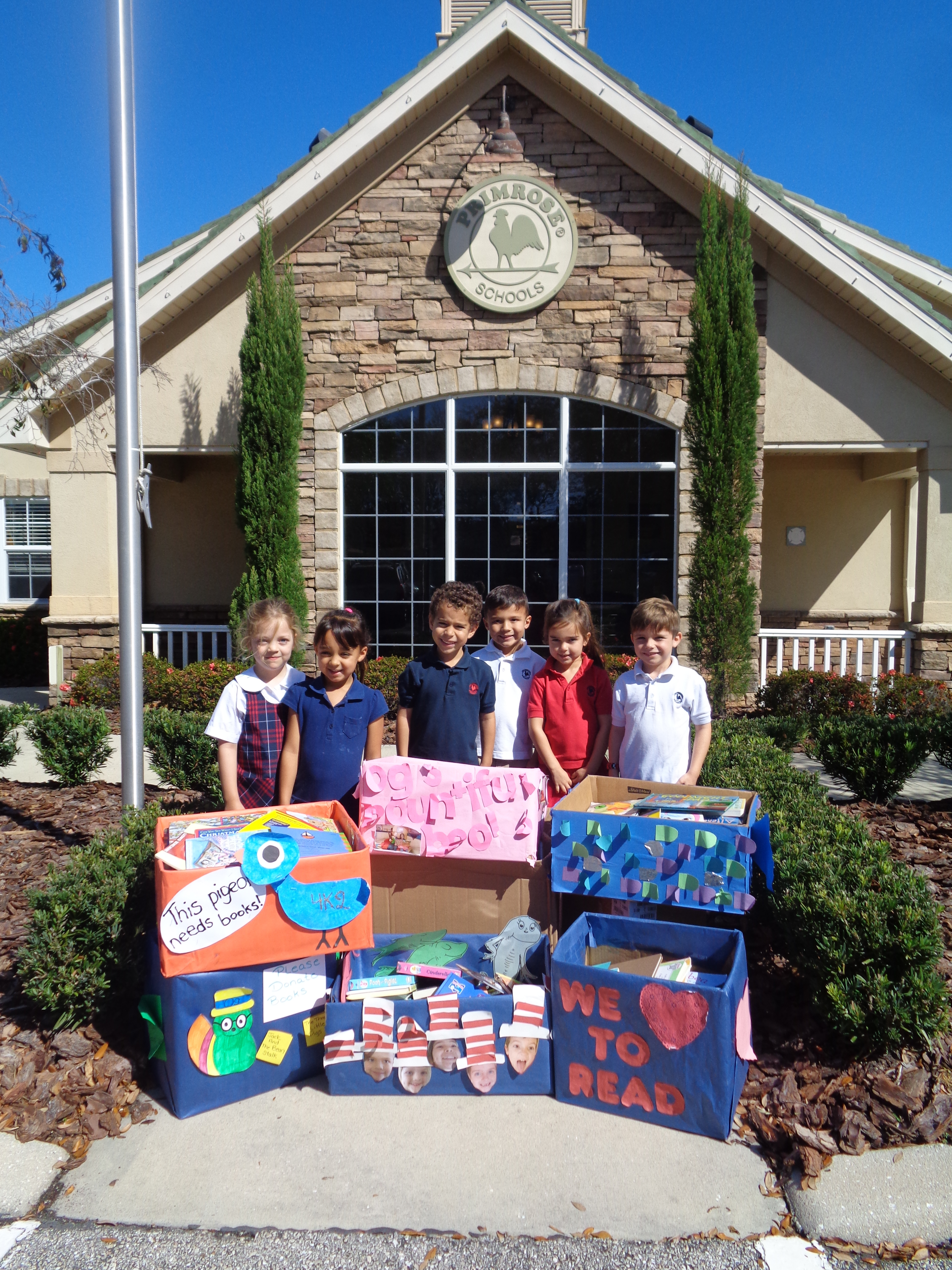 """Primrose students pose with boxes filled with books they donated to the """"Mothers helping mothers"""" foundation"""