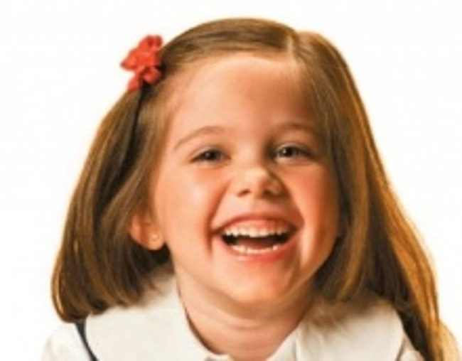 Close up of a young girl laughing heartily