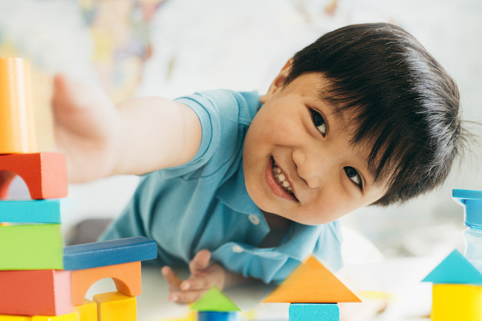 image of boy stacking blocks