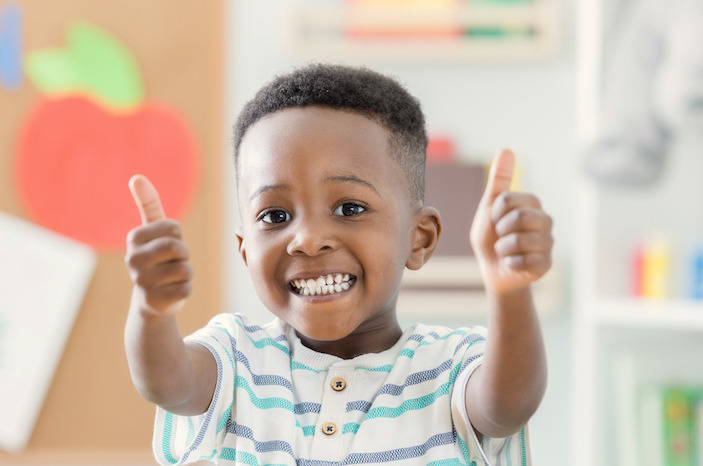 image of little boy giving two thumbs up