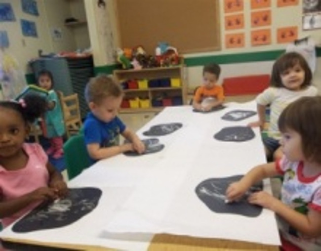Primrose preschoolers draw on small chalkboards in class