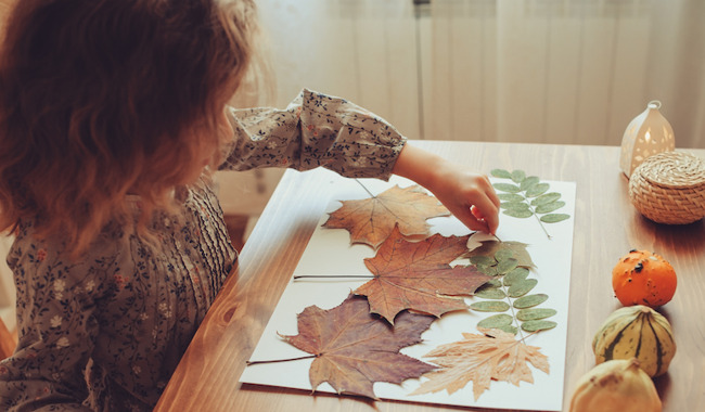 image of girl making a fall craft
