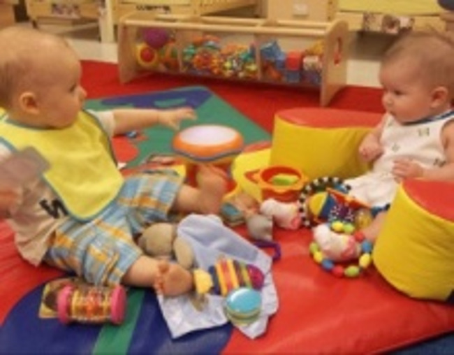 Two infants playing in a Primrose classroom