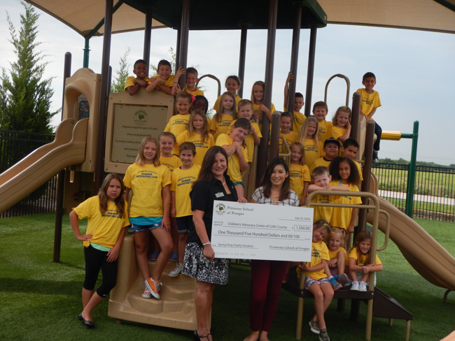 Primrose school of Prosper staff and students hand over a check to a Children's Advocacy Center of Collin representative