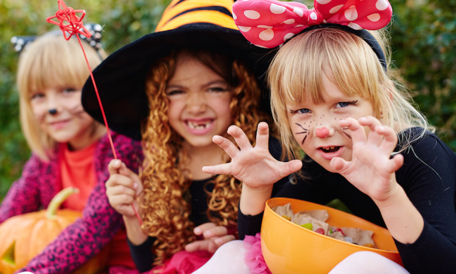 three girls dressed up for halloween