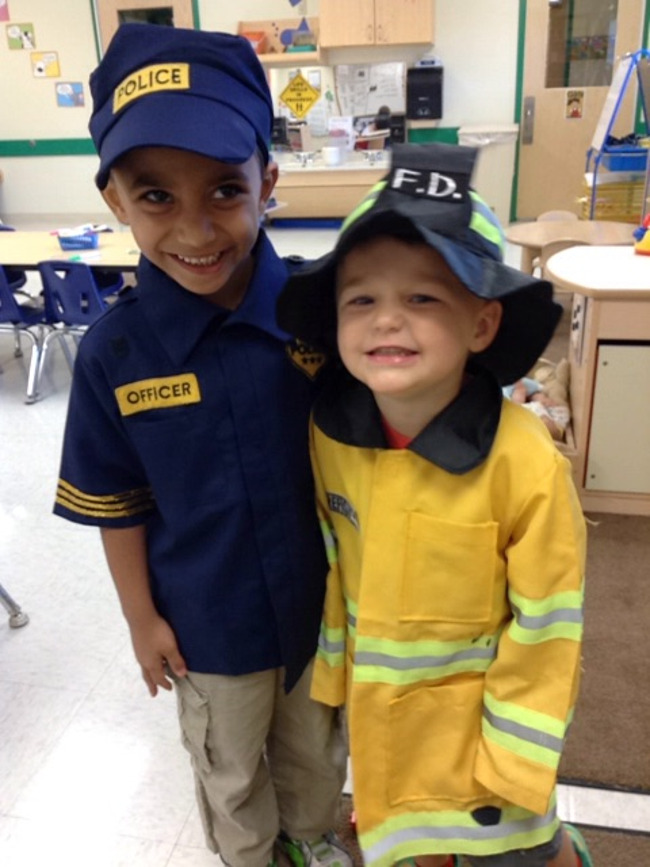 Two Primrose students dress up; one as a police officer and the other as a fireman
