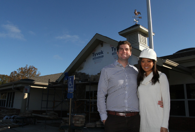 owners standing in front of the school
